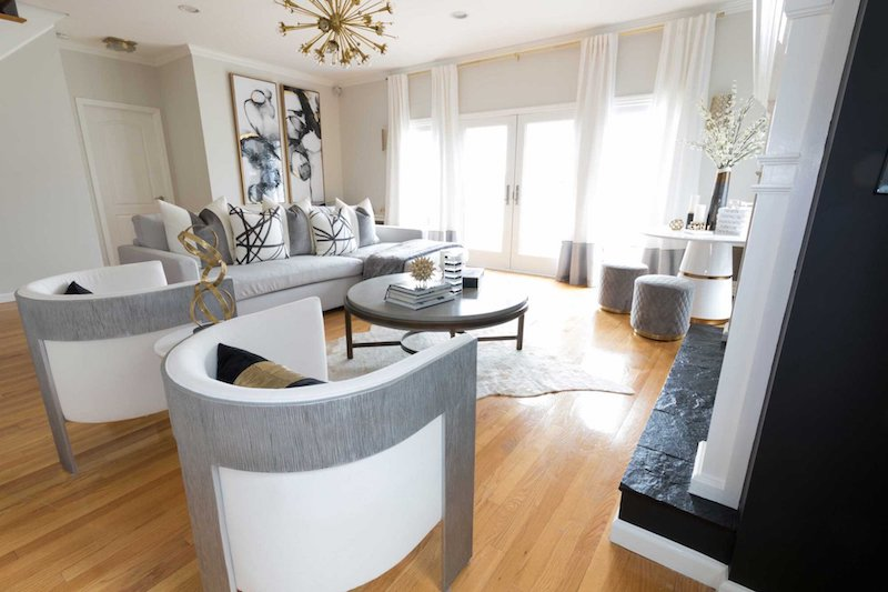 neutral-living-room-with-hide-rug-and-bernhardt-chairs