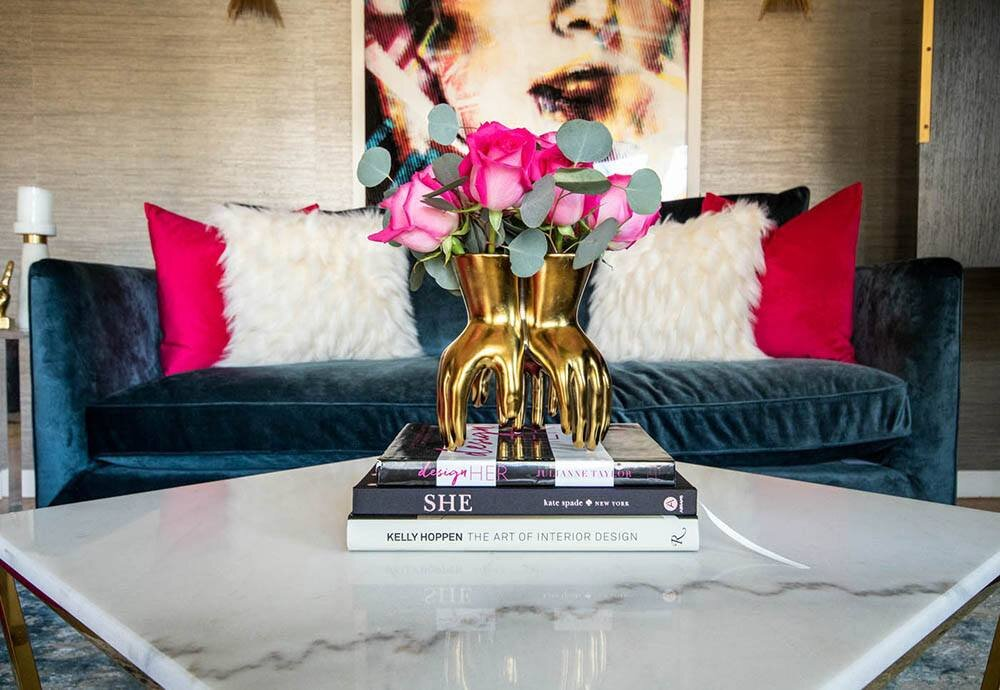 coffee-table-book-decor-with-gold-arteriors-hand-vase-and-pink-roses.jpg