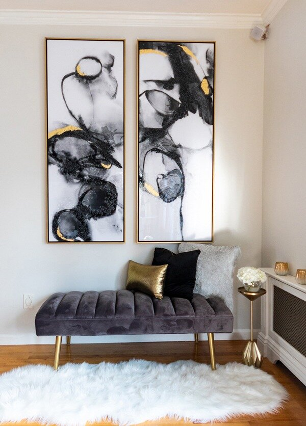 contemporary-black-and-gold-art-with-gray-velvet-bench-fur-rug-600x836
