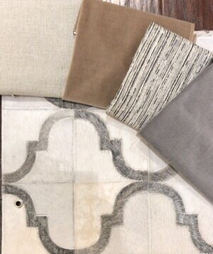 gray-creme-and-tan-color-palette-with-cowhide-rug.jpg