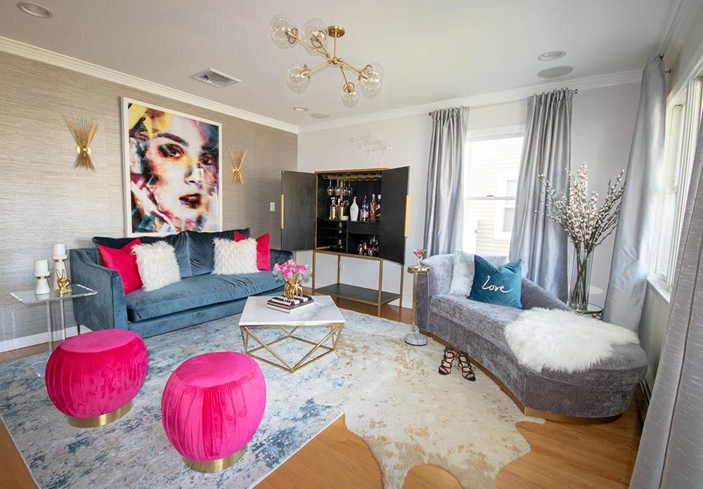 iq-design-living-room-with-sapphire-interior-define-sofa-andpink-velvet-ottomans.jpg