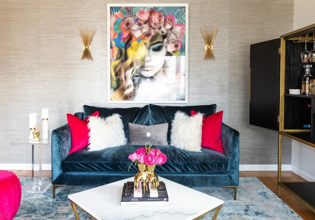 living-room-with-pink-roses-and-blue-velvet-sofa-gold-sconce-1200x840-1